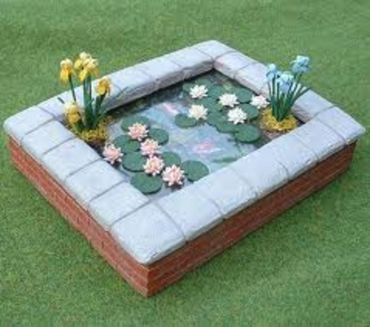 Fish pond made from a sandbox