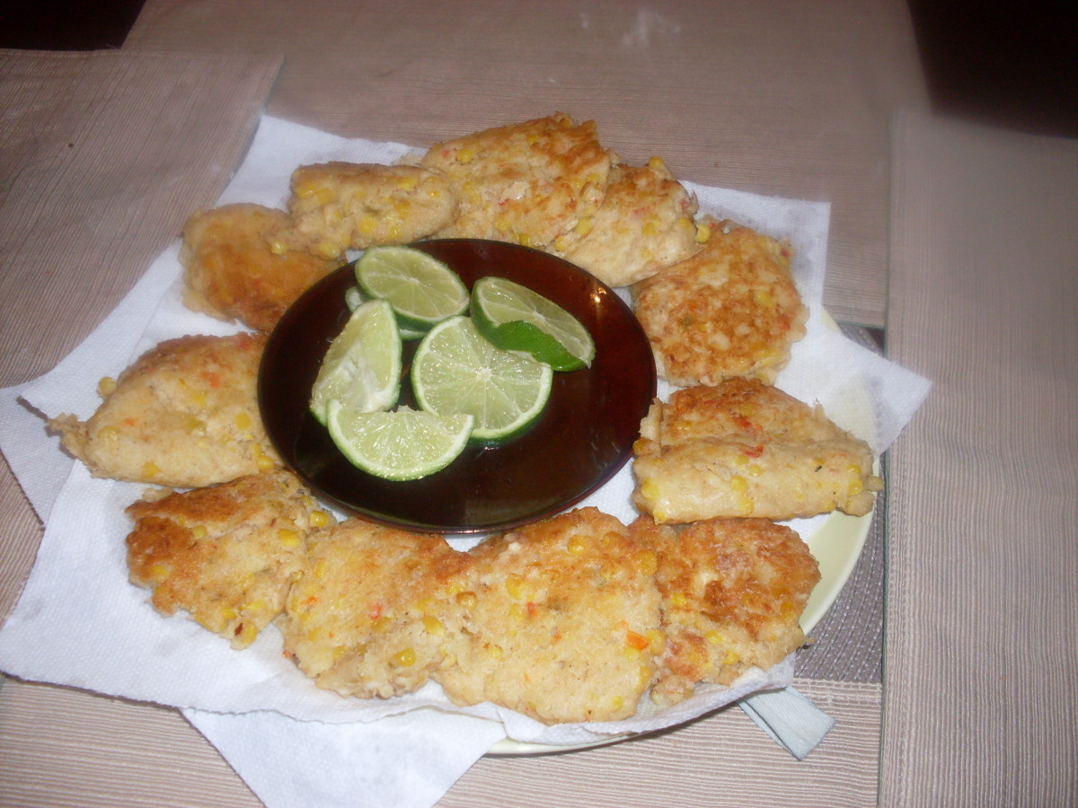 These hot, fresh and delicious homemade tuna fish fritters had canned mexicorn stirred into the fritter batter before the tuna fish fritters were fried in oil in a pan on the stove top.