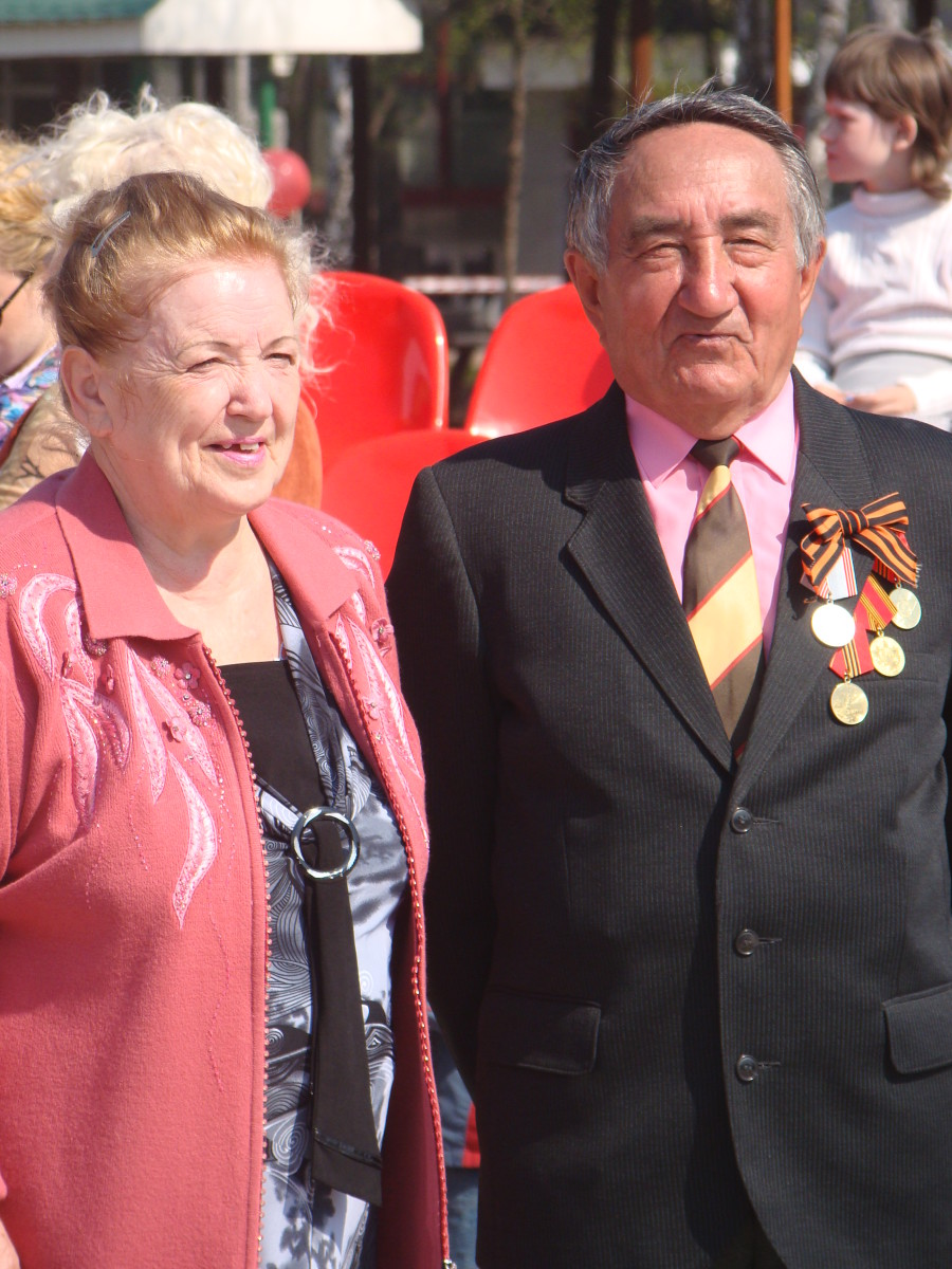 A Russian man and woman begin to remember the dead of World War II, the Great Patriotic Day celebration and holiday