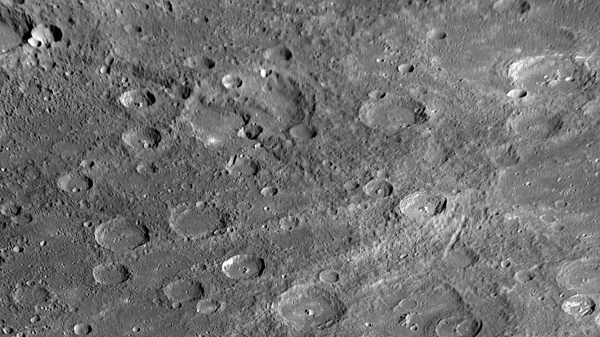 The Mercurian Landscape, including several craters, and a long escarpment top left