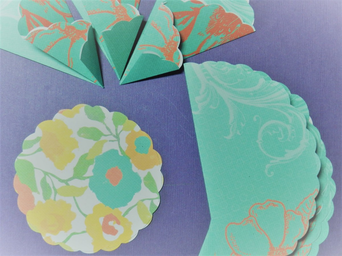 Fold all eight circles into zig zag wedges.  Make a smaller contrasting circle for assembling the rosette.