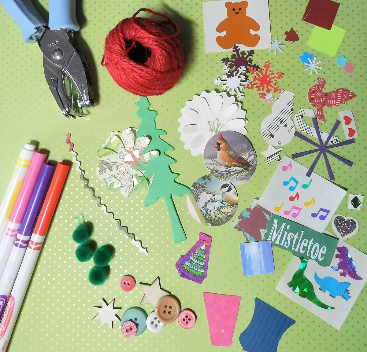 Gather together embellishments, such as, stickers, pens, die cuts and punched Christmas motifs.