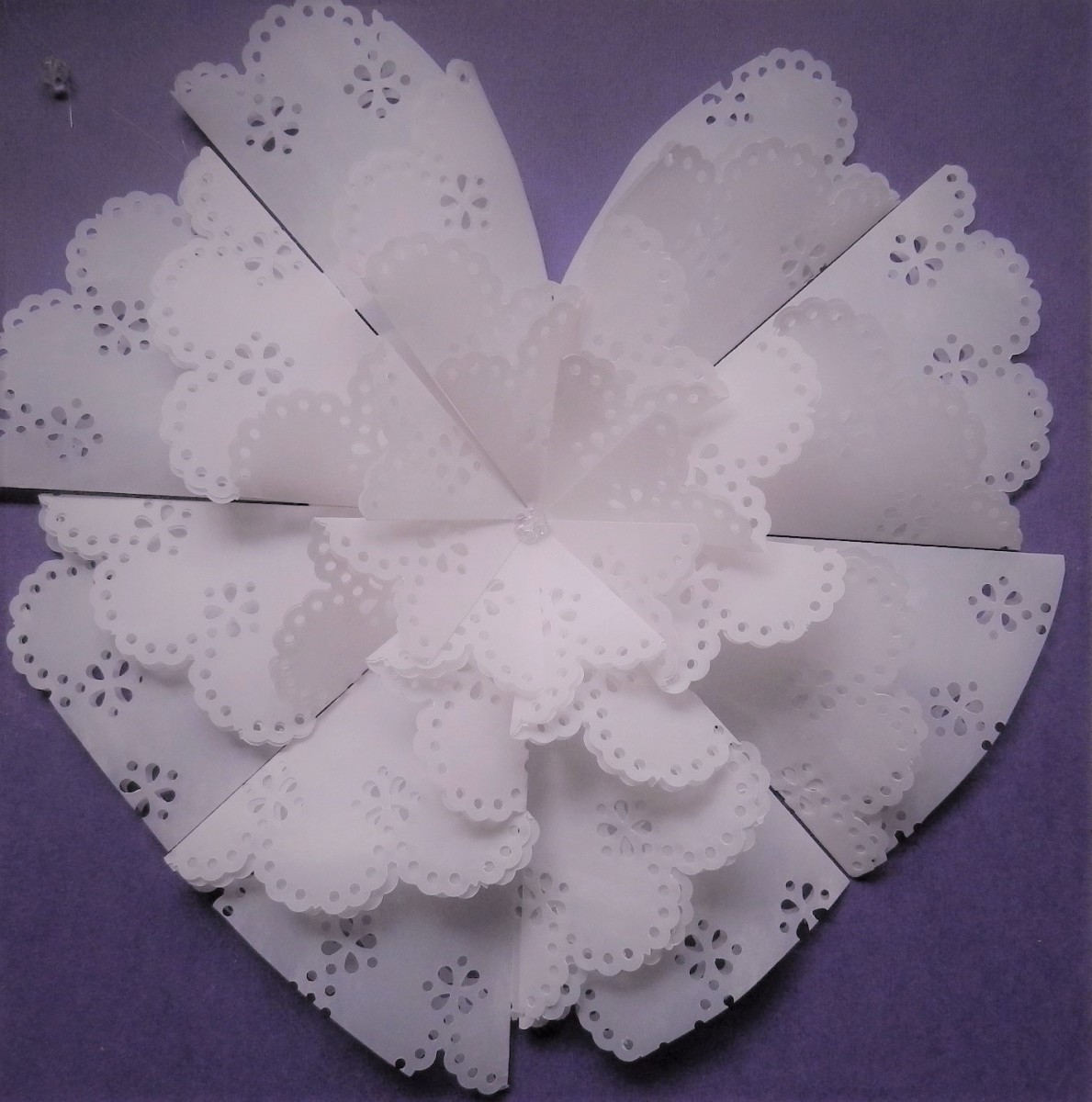 Use a circle doily punch and cut vellum rosette into a heart shape for Valentine's Day.