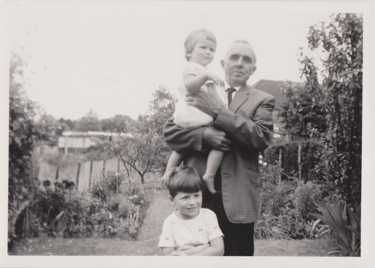 My Grandad holding me, and my brother.
