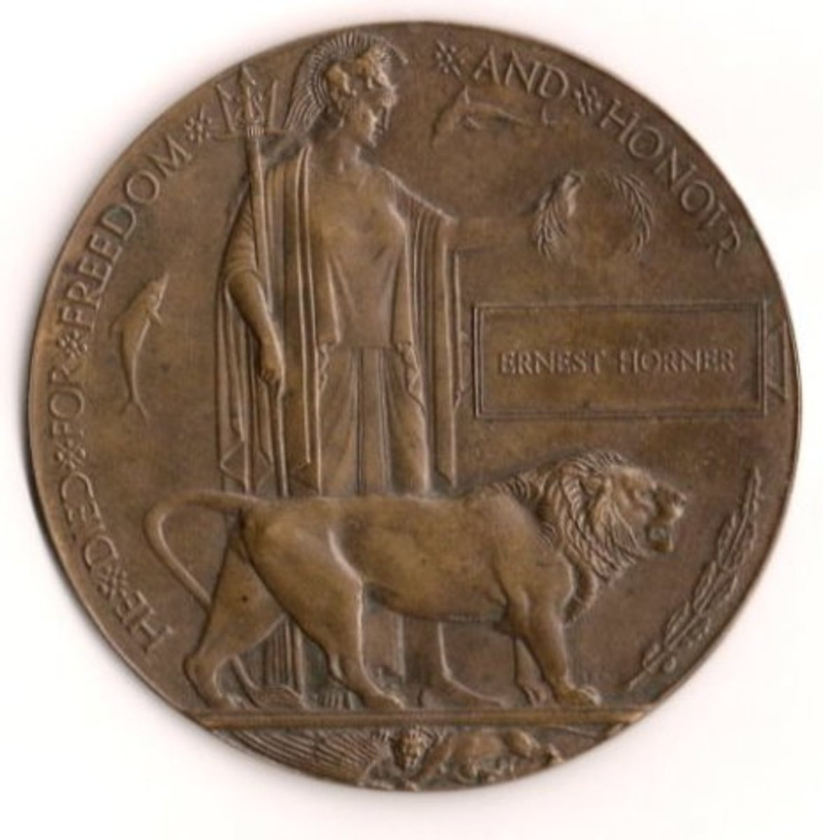 Designed by Edward Carter Preston. ~ Public Domain. - See: http://en.wikipedia.org/wiki/File:Memorial_Plaque.jpg