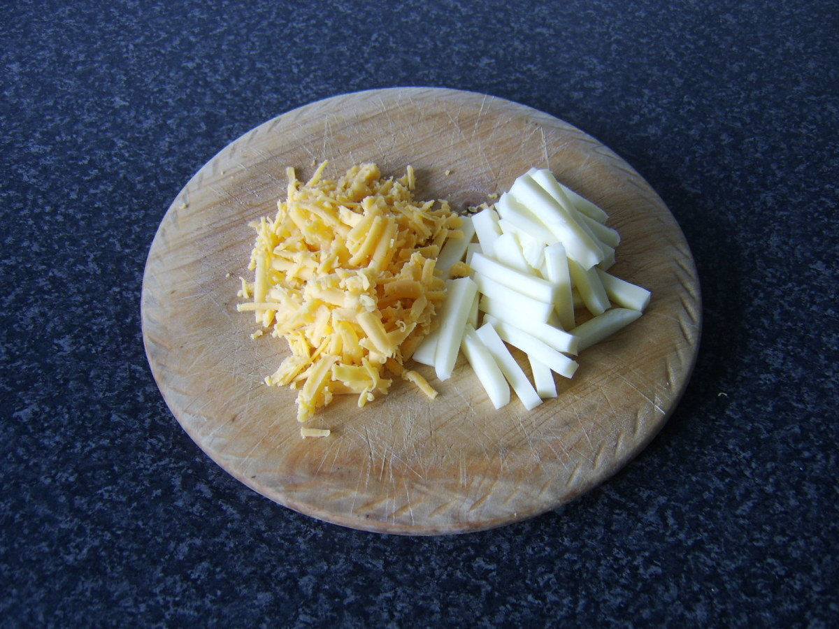 The cheddar cheese is grated and the mozzarella chopped in to one inch strips