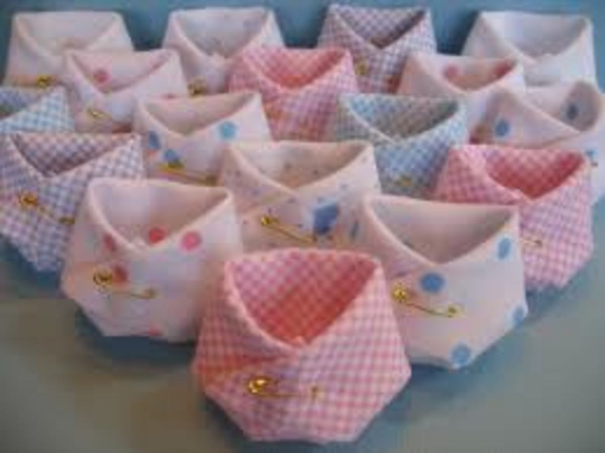 This picture shows how diapers can be used to make cute decorations or it can also be a unique shower gift.