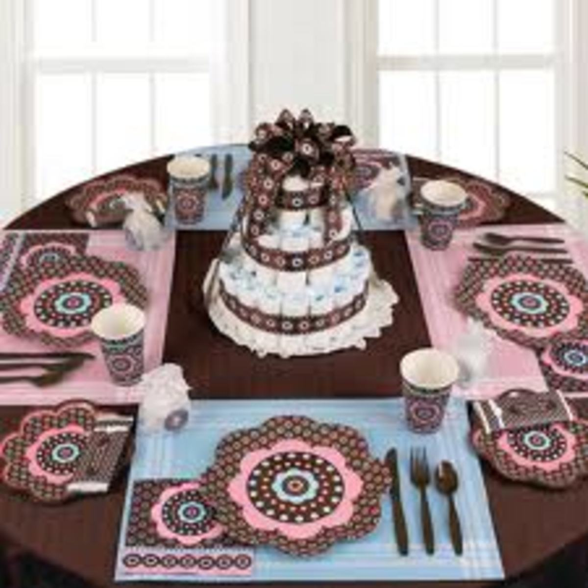 This table piece used both traditional blue and pink with a shade of brown. Notice how everything matches. It is important to use the same color scheme when decorating. It shows order and structure at your shower.