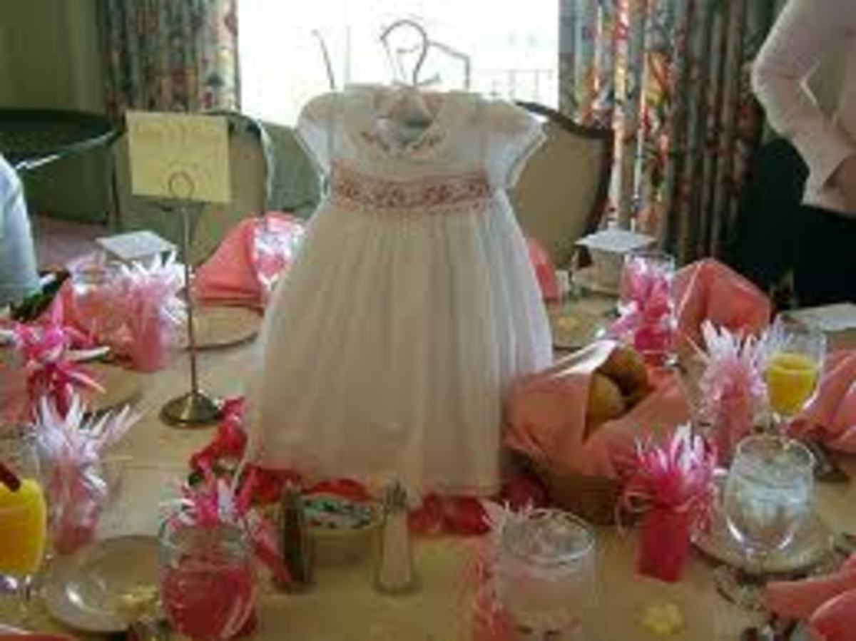 This shows a center piece at a baby shower. Your center piece is the main focus of your decorations and can be used as a background for pictures.