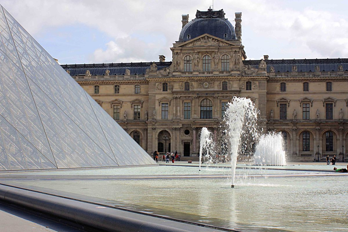 The modern design of the Louvre pyramid, erected in 1988, set against the traditional stone work of the historic building behind. You can decide for yourself if the juxtaposition of ancient and modern works in this instance