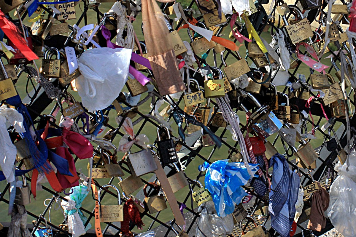 Padlocks and symbols of everlasting love on Le Pont des Arts, as described in the text. This is a pleasing tradition; there isn't room for many more padlocks, but hopefully a way will be found to allow the practice to continue