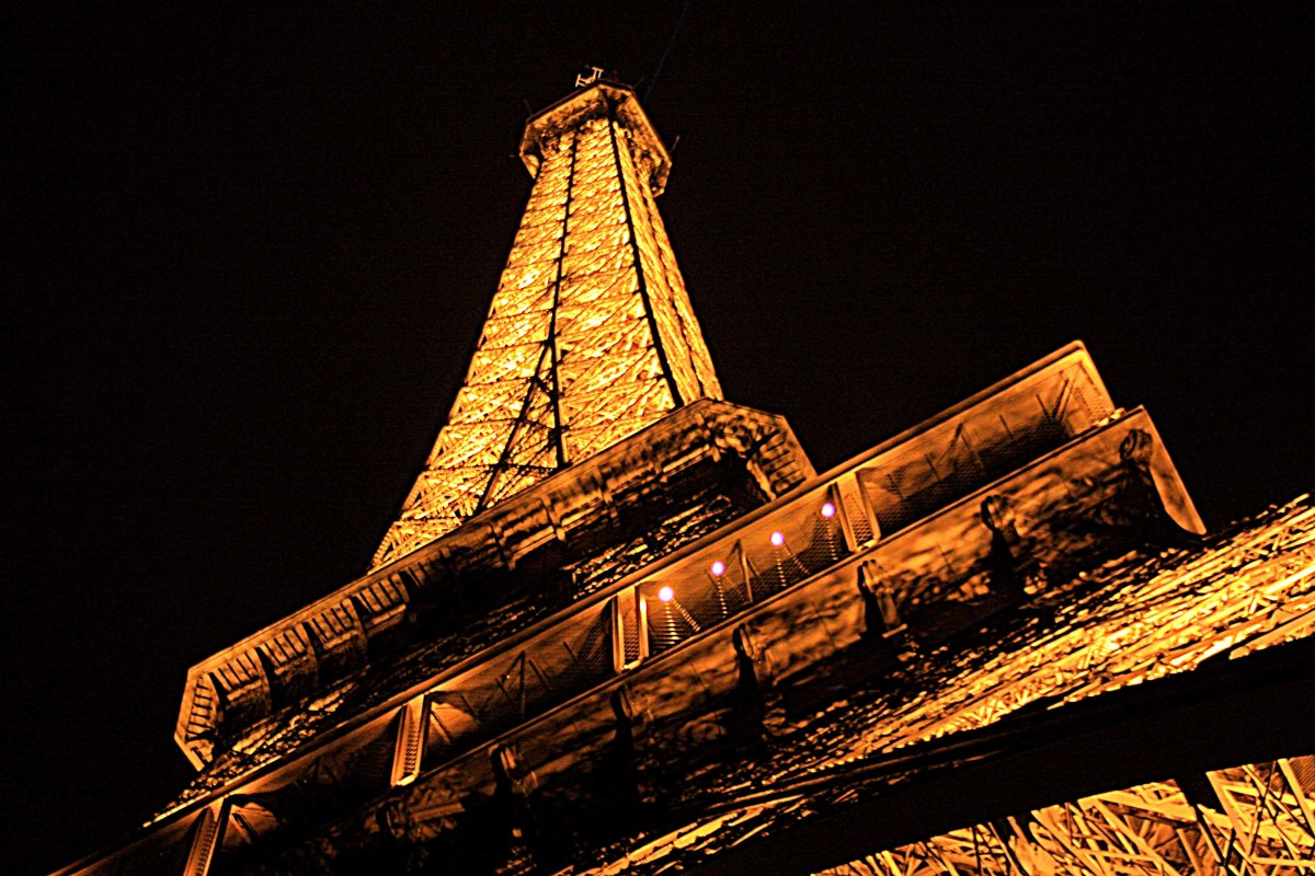 THe Eiffel Tower lights up the night sky. Several more photos showing the Eiffel Tower in all of its night time spleandour will appear of Page 3 of this series