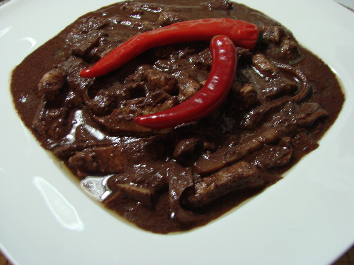 "Pork blood stew ""Dinuguan""~ translate as "" Of blood"". A Filipino dish that taste better than it looks. Similar to European-style blood sausages or the British black pudding"