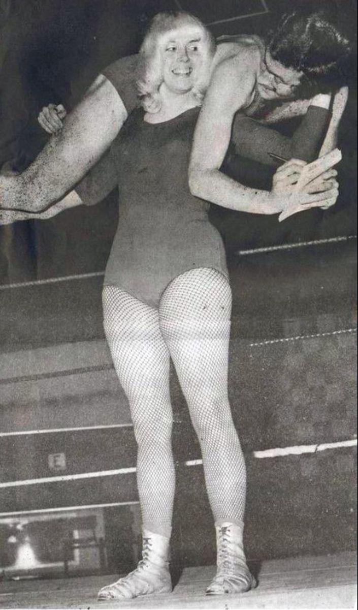 Mitzi Mueller showing off her impressive strength.
