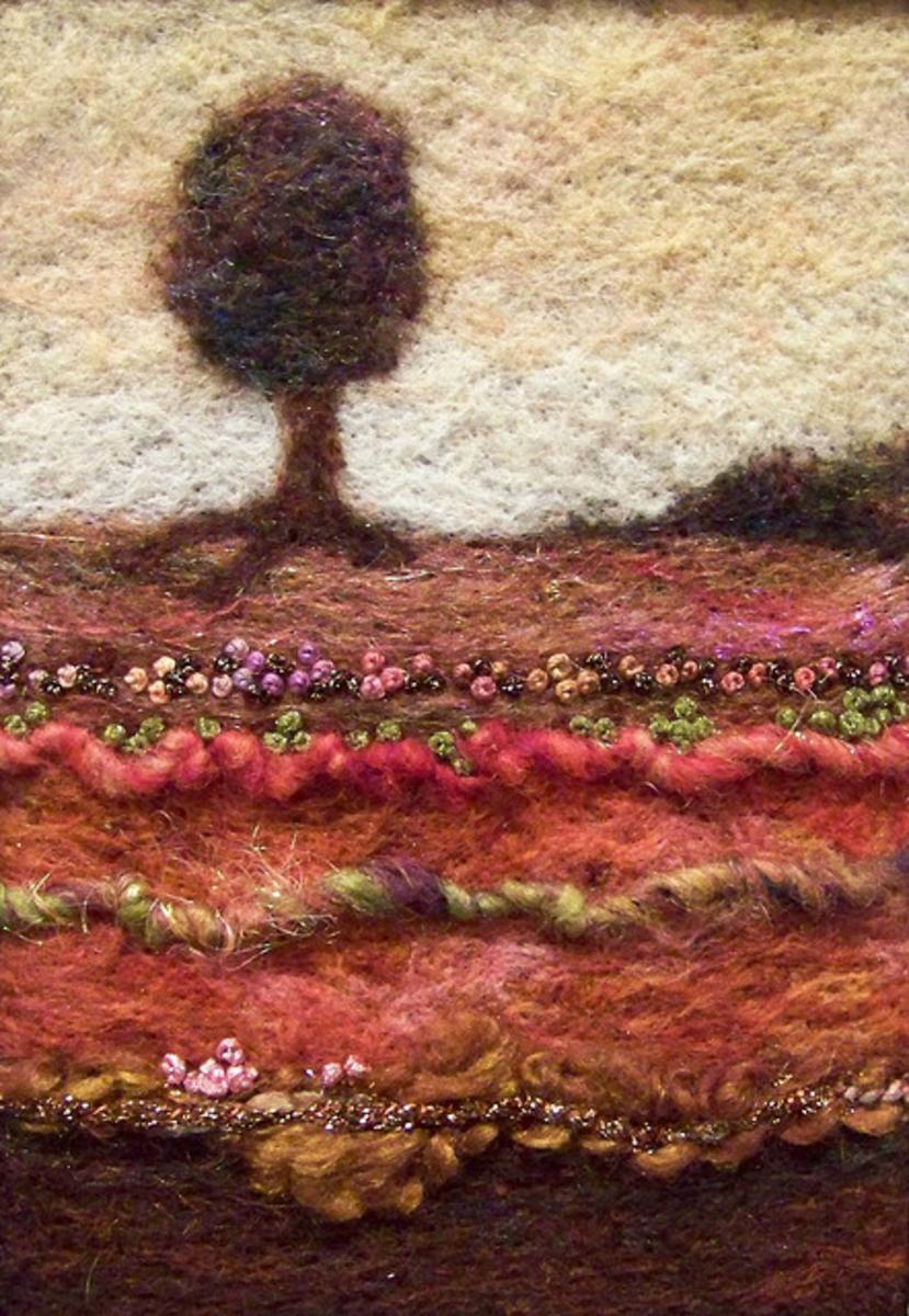 Needlefelt wool on felt with art yarns and embroidery.