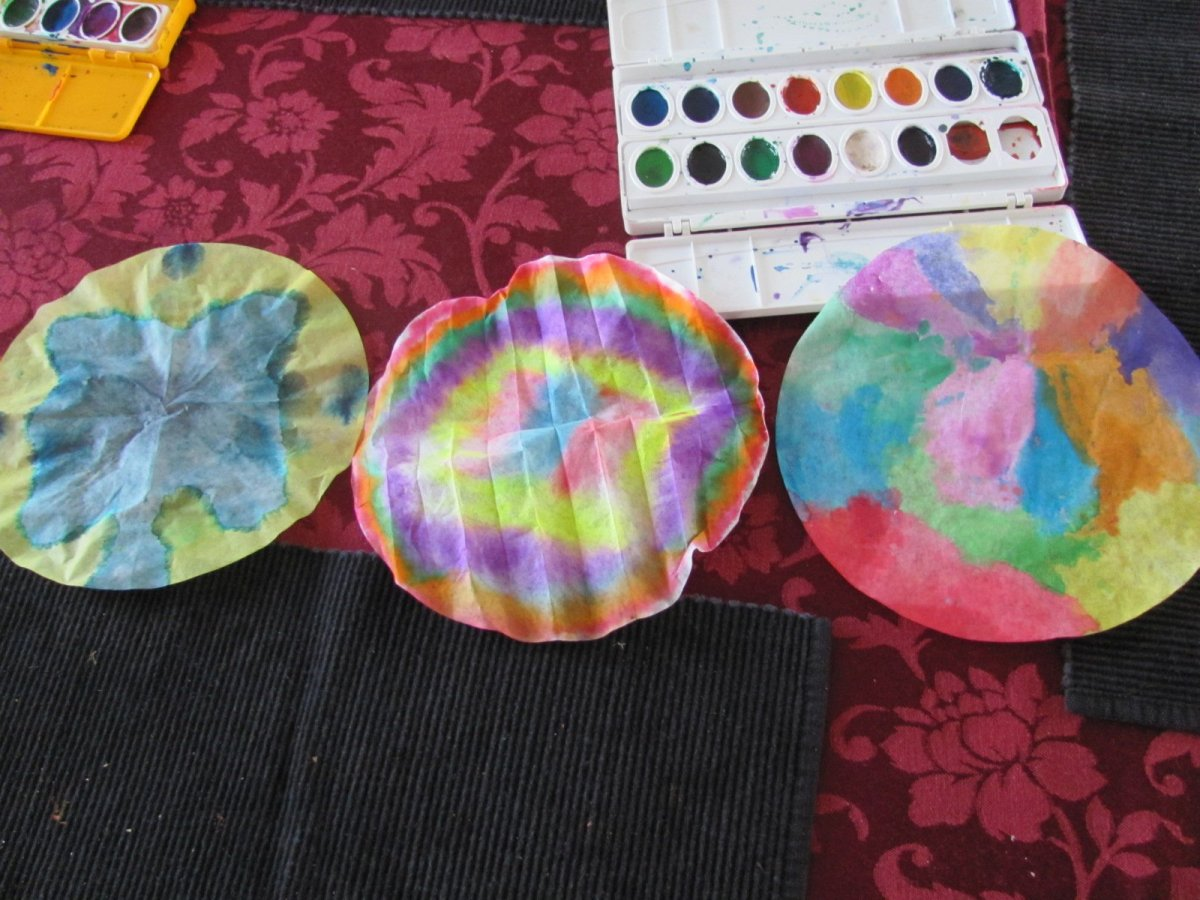 Painted coffee filters ready for the clothes pins