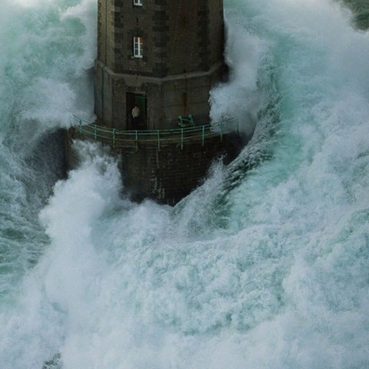 Lighthouse guard in Mare, France must be one of the most courageous people on the planet! Not everyone will have a smoke in such weather, and in such a place!