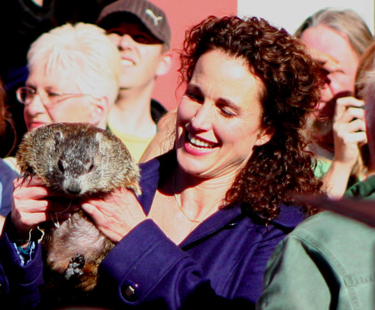 This is Andie MacDowell holding a groundhog - need I say more? Sorry guys, she is not naked - that is another groundhog day tradition of streaking down woodchuck alley.