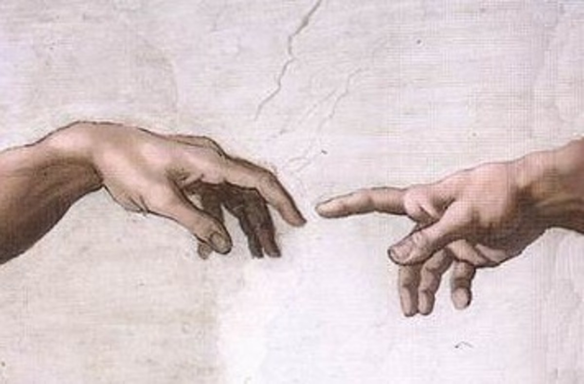 Sistine Chapel ceiling.  God (right) creating man (left) Painted by Michelangelo.