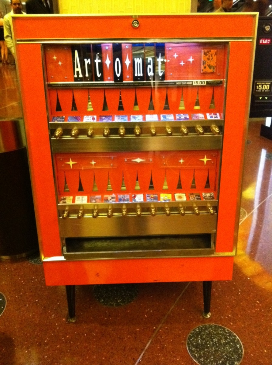 "Another bright Art-O-Mat machine. There is no more excuse to walk around ""artless"" with these around, and for only five dollars, they cost less than a pack of cigarettes!"