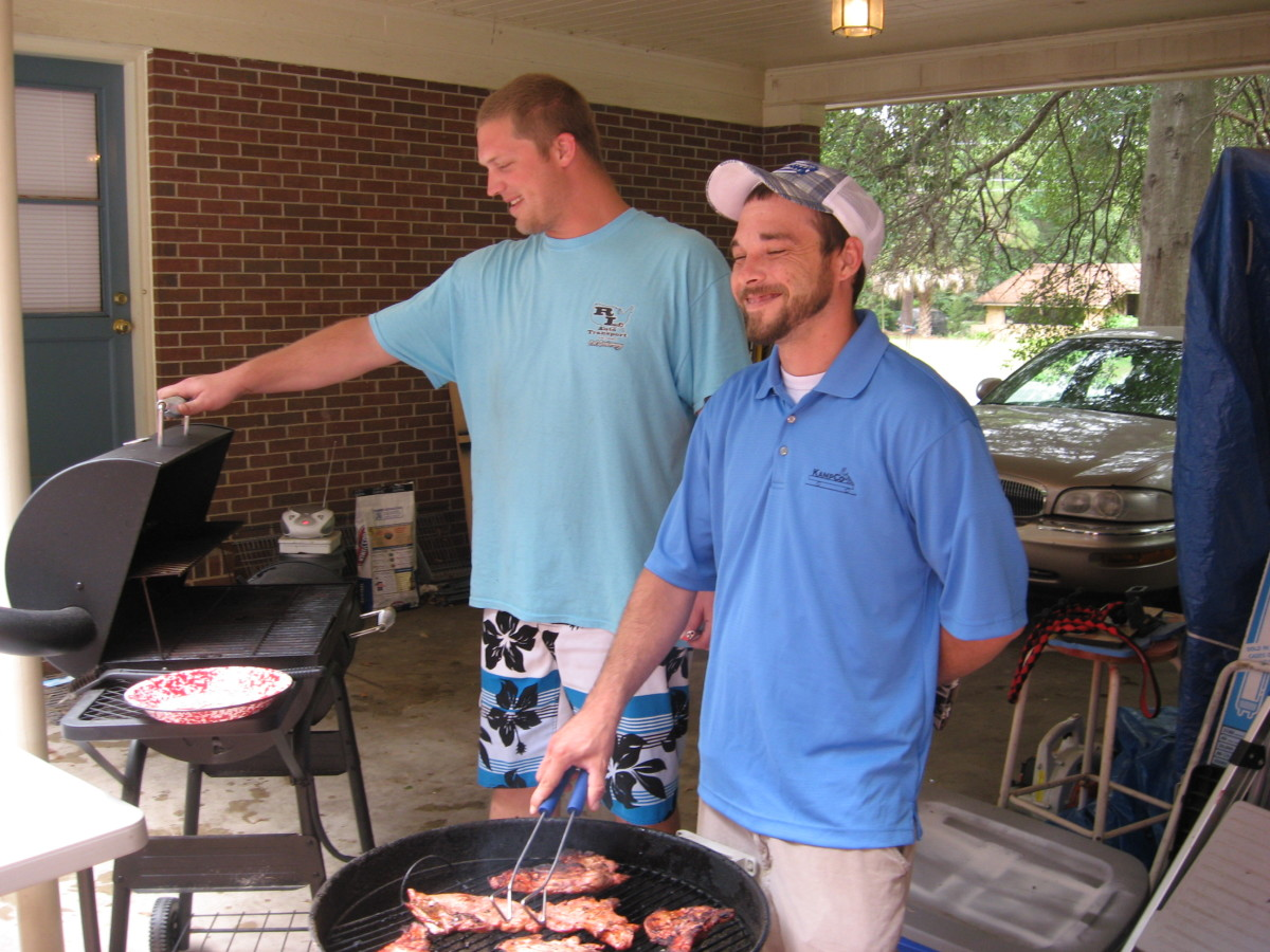 Dueling charcoal grills, starring Cory and Justin. Can you hear the theme of Deliverance playing in the background?