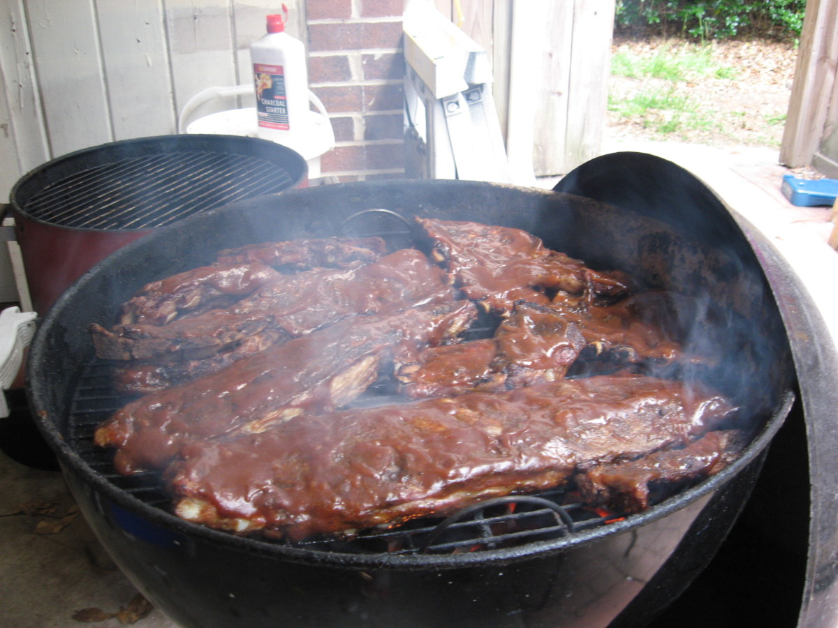 Finish the ribs with sauce and cook over direct heat.