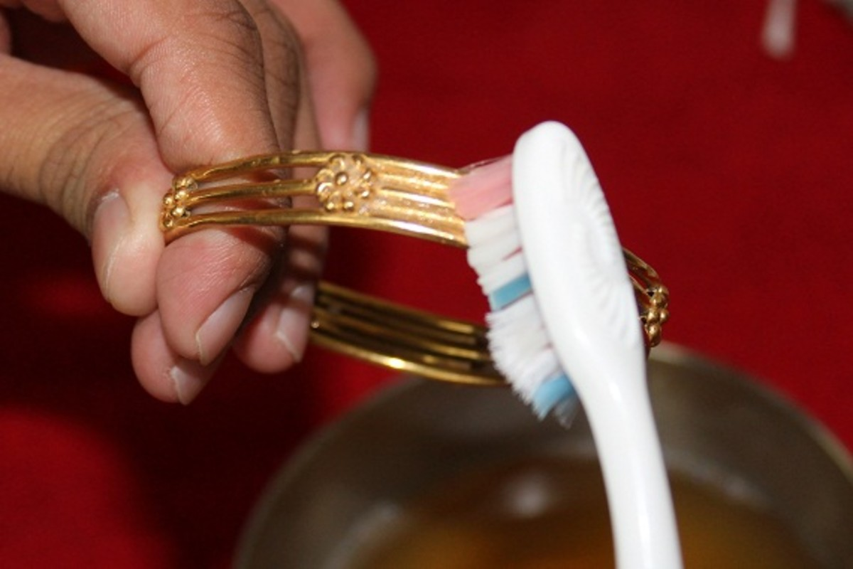 Scrub you jewelry lightly with a toothbrush