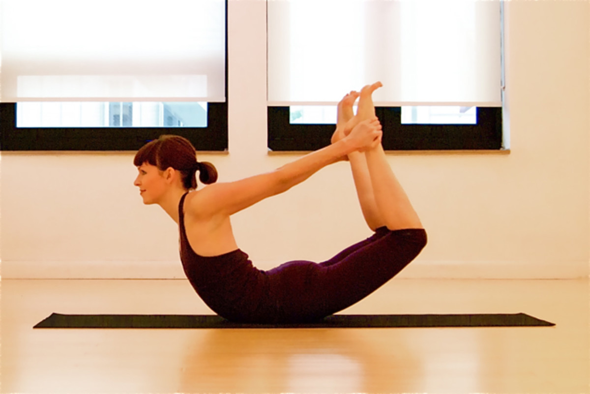 Bow pose.  For those with low back issues, go ahead and do this, but be careful and don't go any farther into this pose than is comfortable for you.