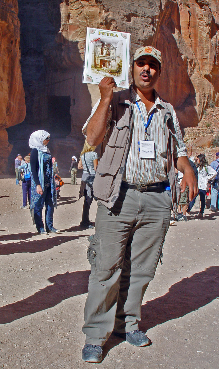 A tour guide in Jordan.  A good guide must be easy to follow, both physically, informationally and visually.  Concentration, training and practice makes perfect!