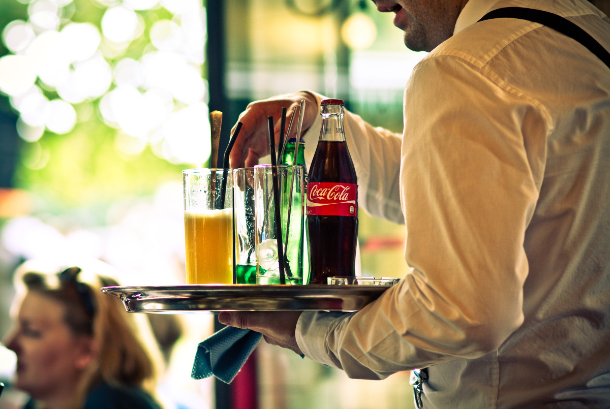 Those who think tips are something extra do not realize the level of training a preparation required to be a good service representative, no matter what the industry.  Here, a waiter serves chilled drinks in Paris.