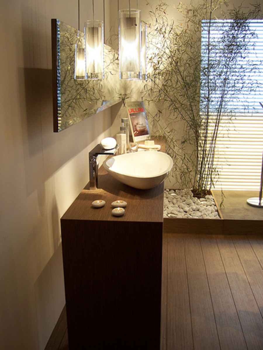 A Contemporary Zen Bathroom With Wood Flooring And Eye Catching Lighting  Fixtures