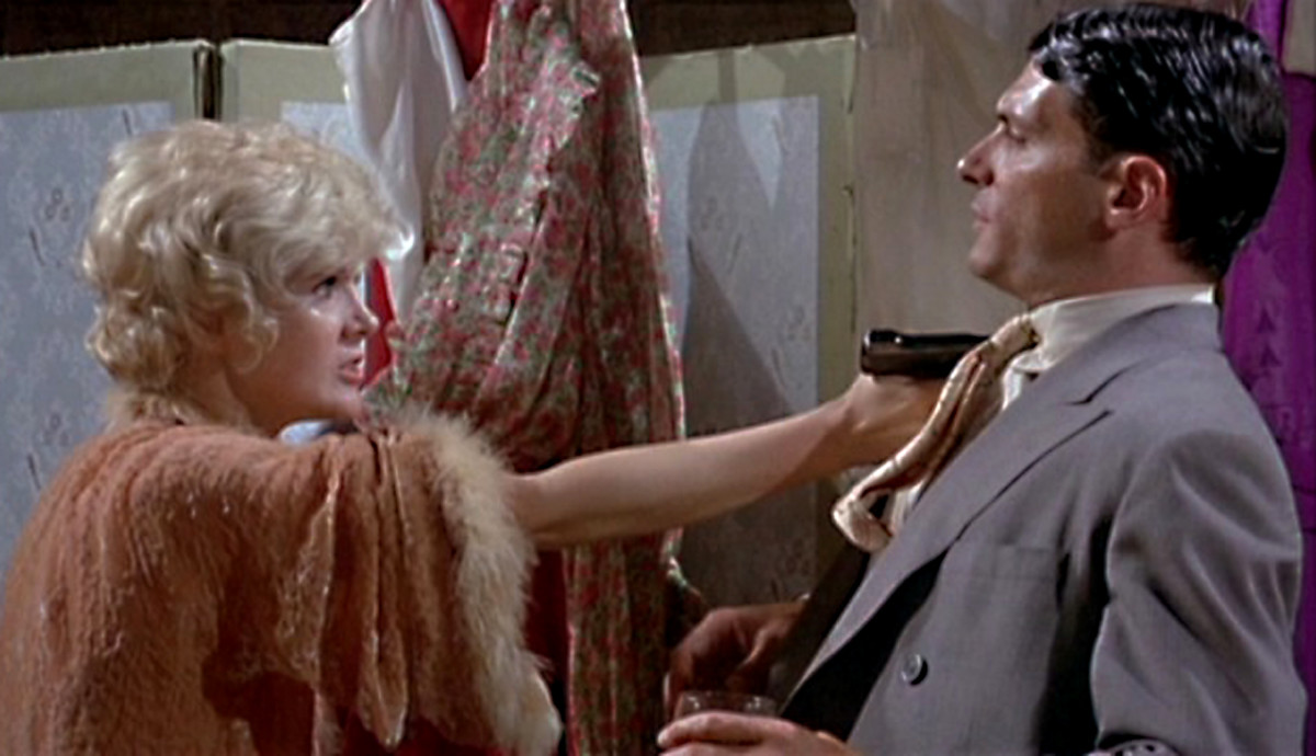 Annie Borg (Connie Stevens) and Eddie Hagen (Tony Musante) have a difference of opinion in the course of their tempestuous relationship