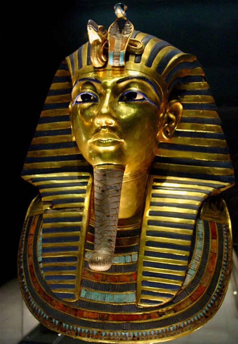 The solid gold burial mask, with glass and semi-precious stone inlays, which covered the face of Tutankhamun's mummy.