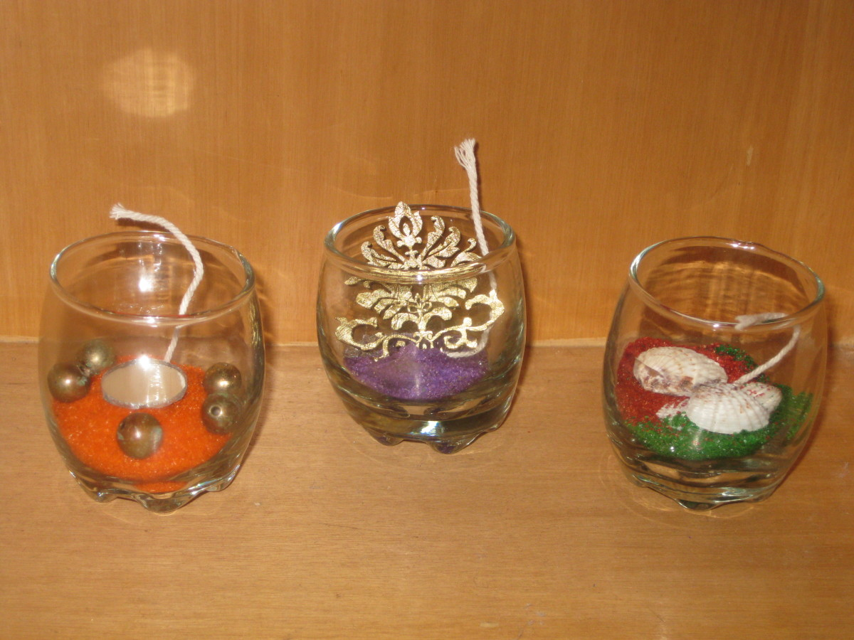 Sort the kit materials and mini-decorations inside the candle-holders.