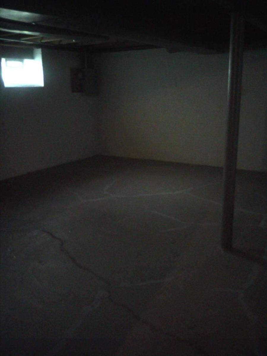 This is our basement before we started painting.  Could be worse, but it sure looked great with some paint!