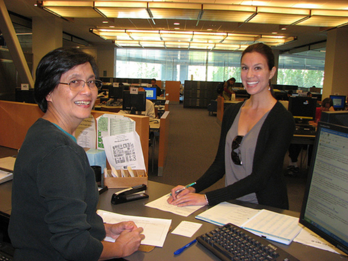 SJSU Librarian Helps Student in Reference - SJSU Librarian Helps Student at Reference Desk, 2nd floor King Library.