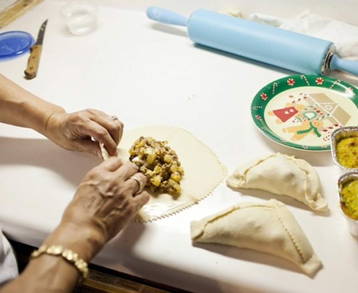 Filling and wrapping empanadas