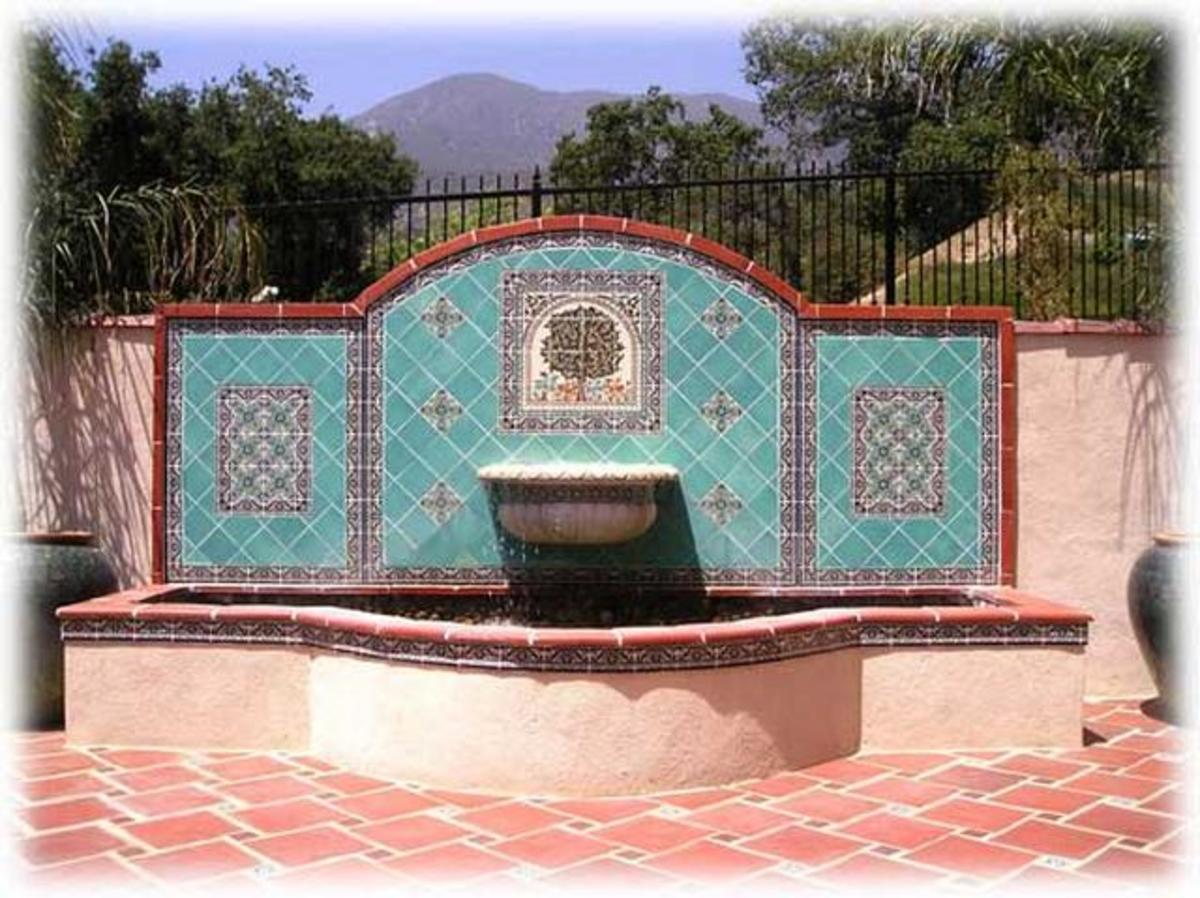 very large blue, teal and tan water fountain with terracotta tile patio - distinctively Mediterraneon