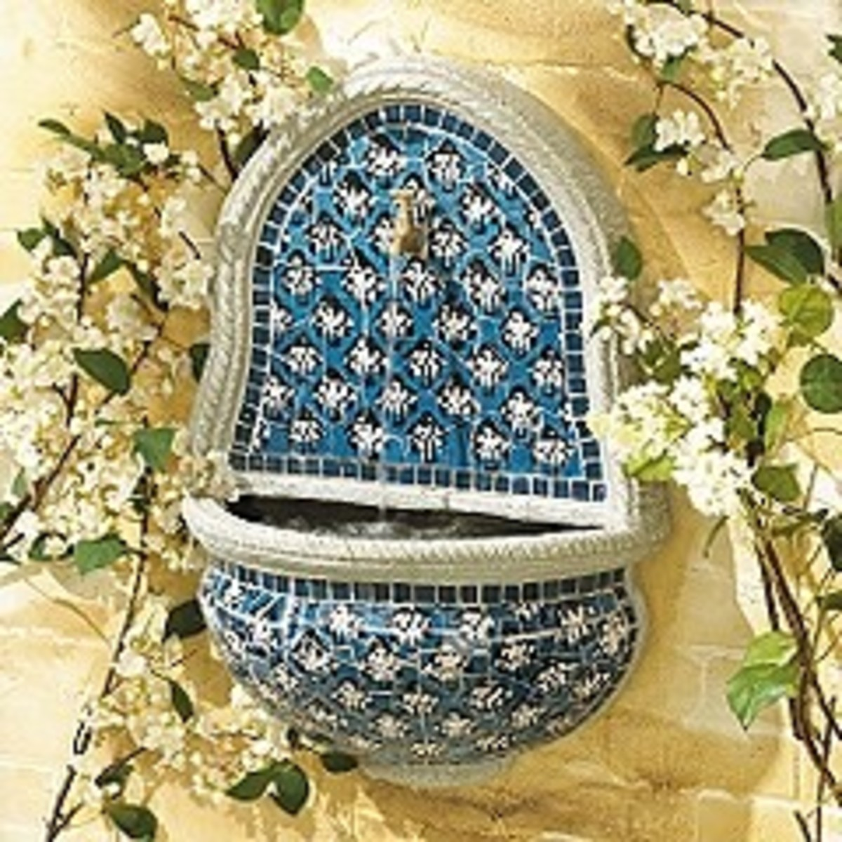 blue and white water fountain - ideal for the Mediterranean garden