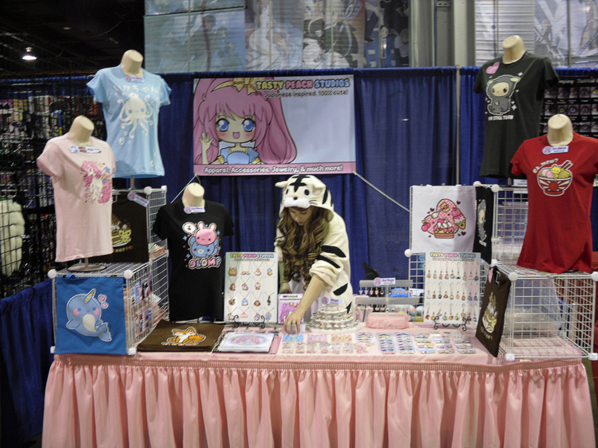 Mooglegurl's Booth at ACEN 2011 - notice she's used height to good advantage.  Her products can be seen from quite a distance.