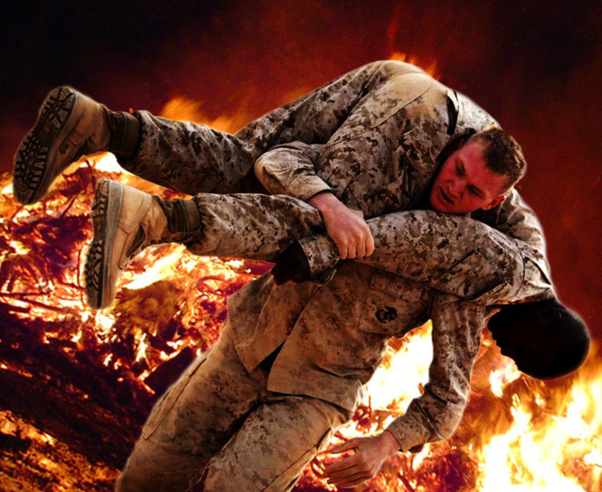 A soldier performing the fireman's carry to save a life.