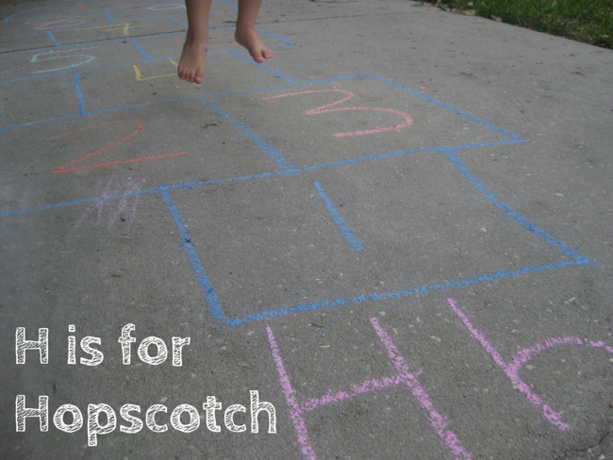 H is for Hopscotch! Nothing fancy: just chalk squares on the driveway with numbers and the girls bouncing over them.
