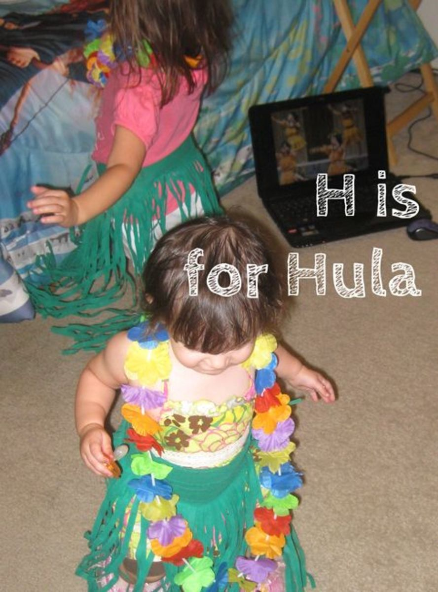 My Hawaiian princesses watching Hula videos on my laptop while Hula dancing!
