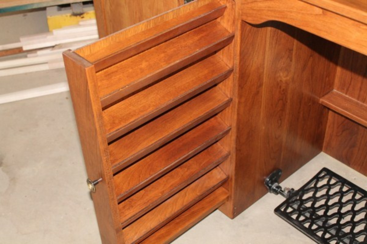 Pull out drawer spool racks are standard on most sewing cabinets.