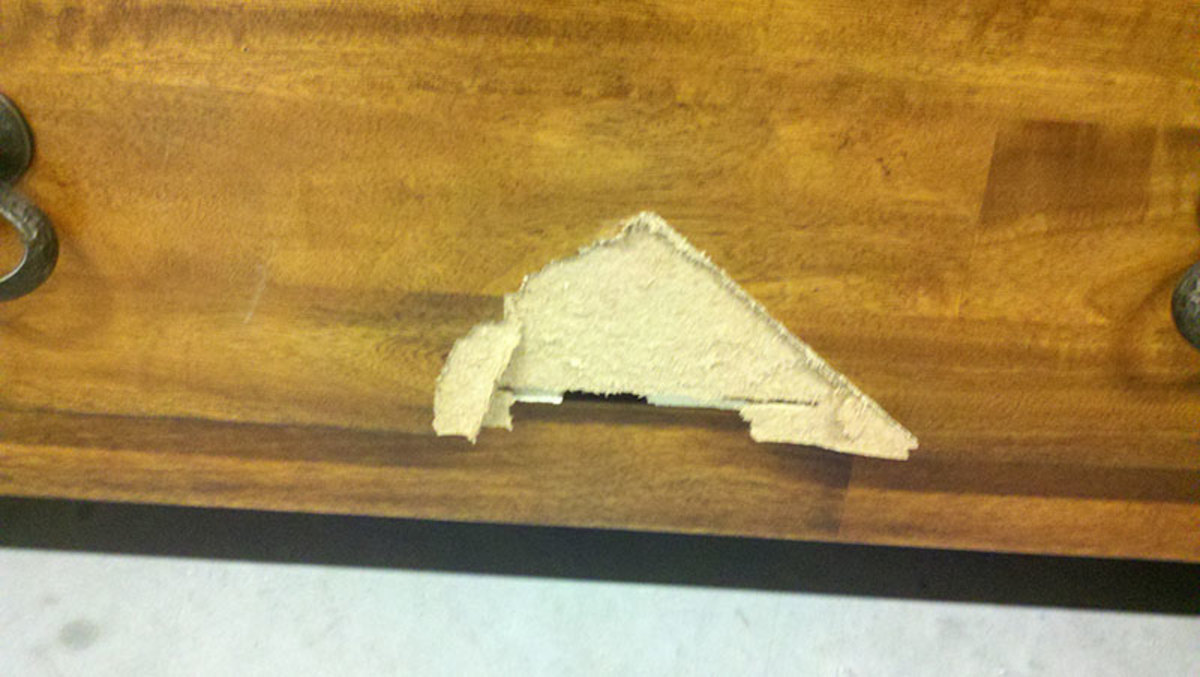 Particle board laminate covered furniture chips out very easily and is impossible to repair.