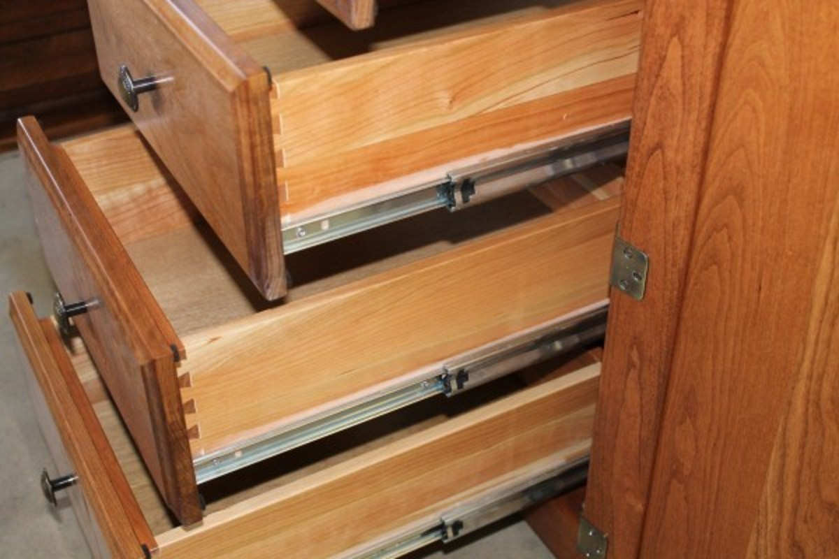 Dove tail of fashioned drawer construction.  Note the high end drawer slides.