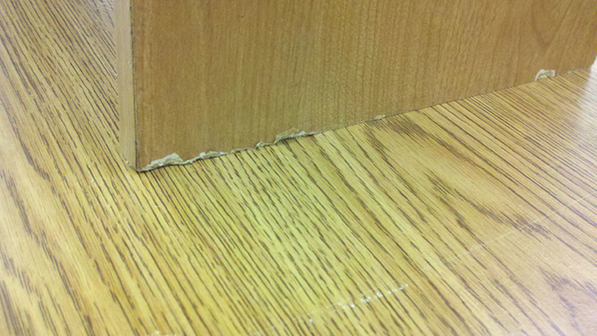 Bottom edges of particle board cabinet legs chip and wear when they are drug on carpeted areas.