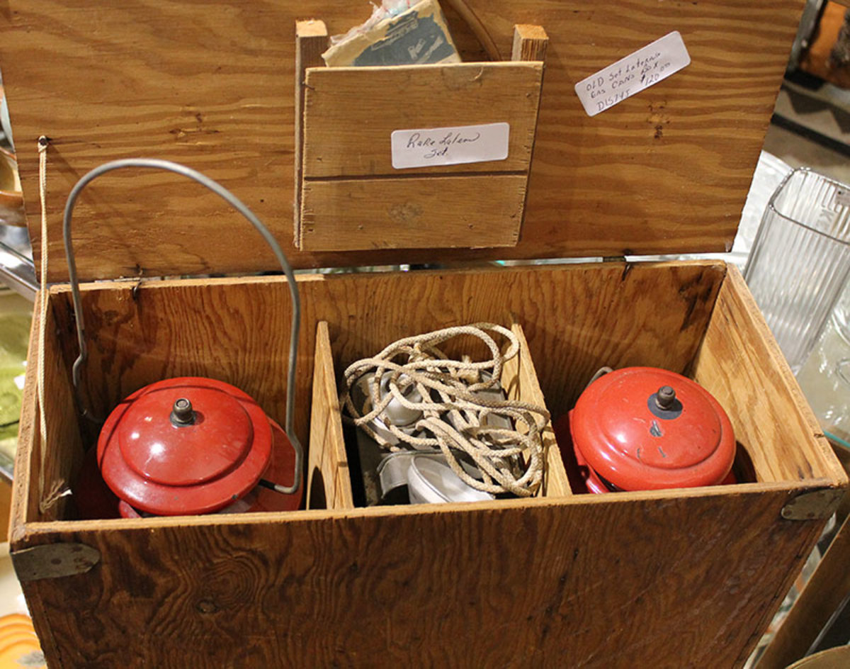 Wooden boxes were often made to store and carry camping equipment like these lanterns.