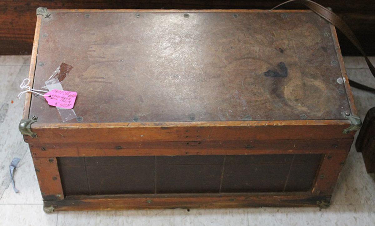 A vintage wooden foot locker
