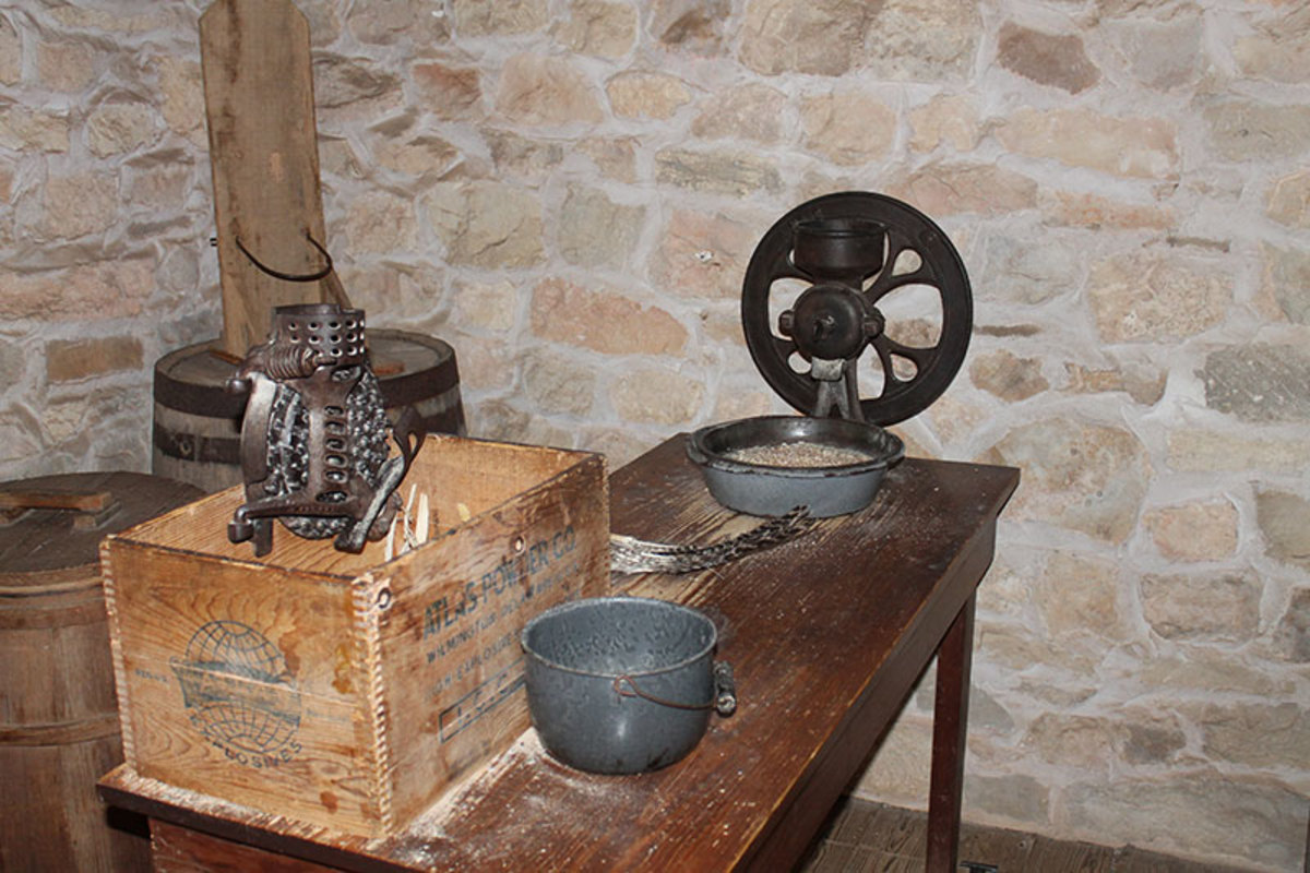 Wooden boxes were used for collection of food products from hand crank processors.
